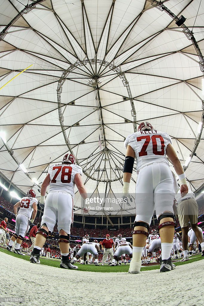 Offensive linesmen Chad Lindsay #78 and Ryan Kelly #70 of the Alabama Crimson Tide warm up prior to the start of their SEC Championship Game against the Georgia Bulldogs at the Georgia Dome on December 1, 2012 in Atlanta, Georgia.
