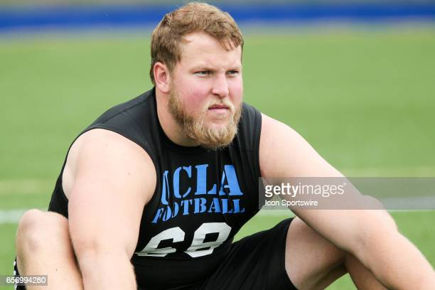 Offensive Lneman Conor McDermott stretching before he starts his drills in UCLA bruins Pro day at Spaulding Field in Los Angeles CA Photo by Jordon...