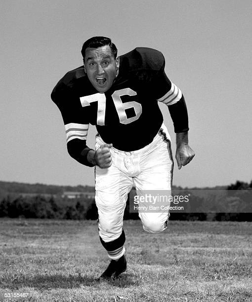 Offensive Tackle and Placekicker Lou Groza of the Cleveland Browns poses for an action portrait during training camp in July 1960 at Hiram College in...