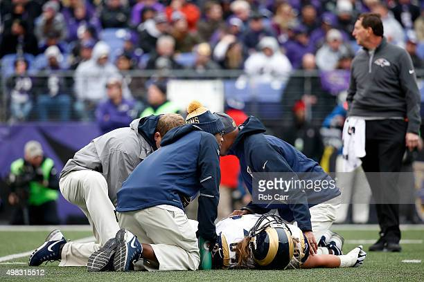 Offensive tackle Andrew Donnal of the St Louis Rams lays on the field injured against the Baltimore Ravens in the second quarter at MT Bank Stadium...