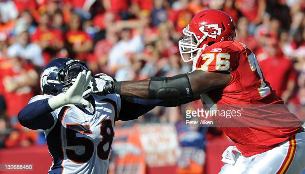 Offensive tackle Branden Albert of the Kansas City Chiefs blocks linebacker Von Miller of the Denver Broncos during the first half on November 13...