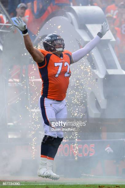 Offensive tackle Garett Bolles of the Denver Broncos runs onto the field during player introductions before a game against the Oakland Raiders at...