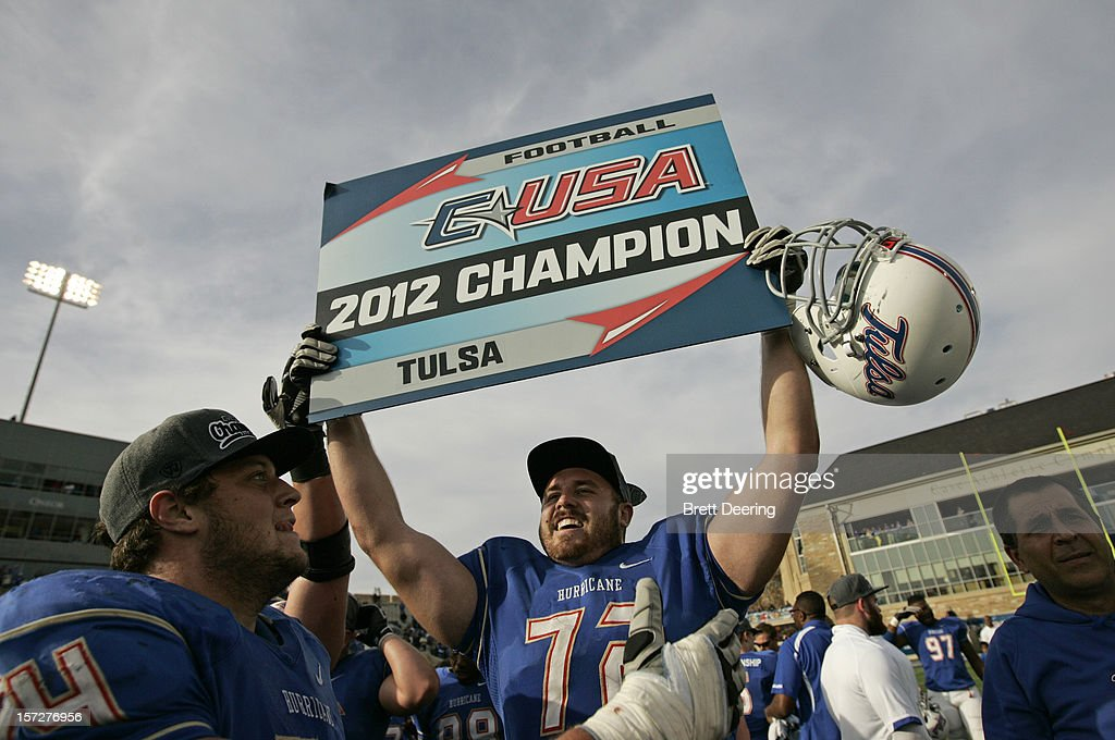 Offensive tackle Jared Grigg #72 of the Tulsa Golden Hurricane celebrates after the C-USA championship game against the Central Florida Knights on December 1, 2012 at H.A. Chapman Stadium in Tulsa, Oklahoma. Tulsa defeated Central Florida 33-27 in overtime.