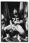 Offensive tackle John Vella of the Oakland Raiders sits in the locker room following the 1976 AFC Divisional Playoff Game against the New England...