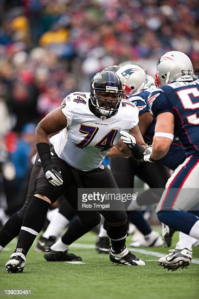 Offensive tackle Michael Oher of the Baltimore Ravens defends his position during the AFC Championship Game against the New England Patriots at...