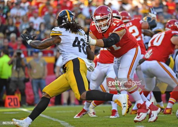 Offensive tackle Mitchell Schwartz of the Kansas City Chiefs blocks linebacker Bud Dupree of the Pittsburgh Steelers during the second half on...