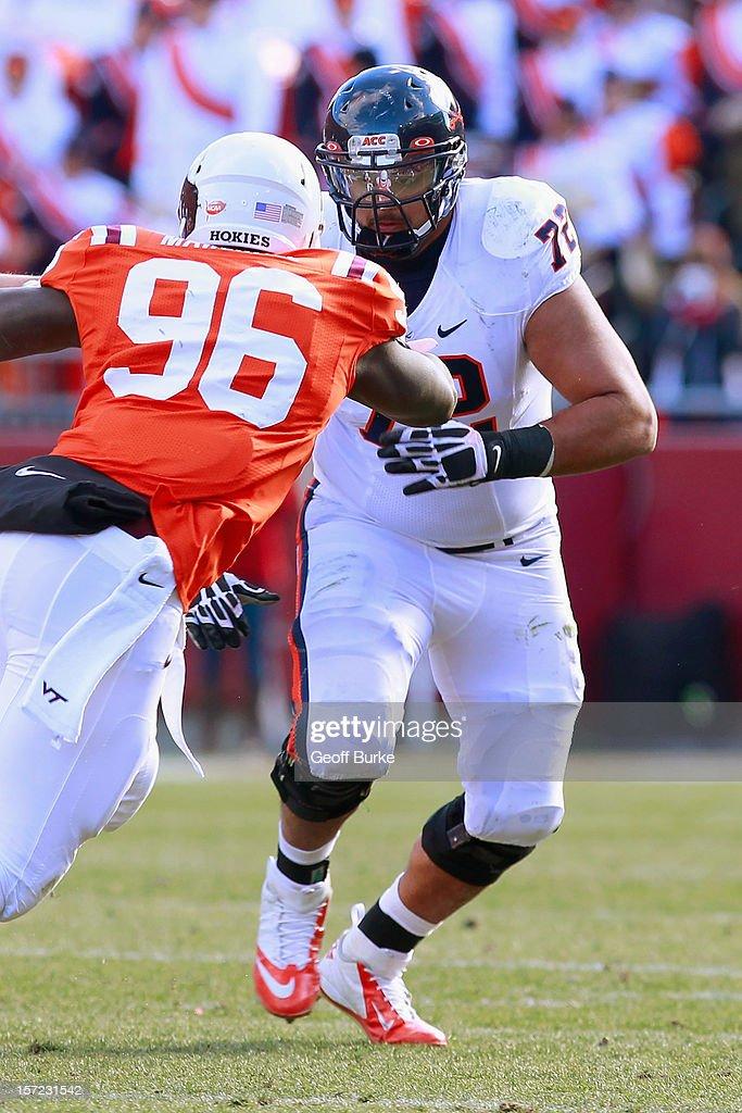Offensive tackle Oday Aboushi #72 of the Virginia Cavaliers blocks against the Virginia Tech Hokies at Lane Stadium on November 24, 2012 in Blacksburg, Virginia.