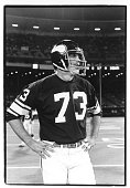 Offensive tackle Ron Yary of the Minnesota Vikings stands on the field before the Monday Night Football game against the San Francisco 49ers at...