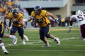 Offensive tackle Ryan Stanchek of the West Virginia University Mountaineers blocks against the Mississippi State Bulldogs on October 20 2007 at Milan...