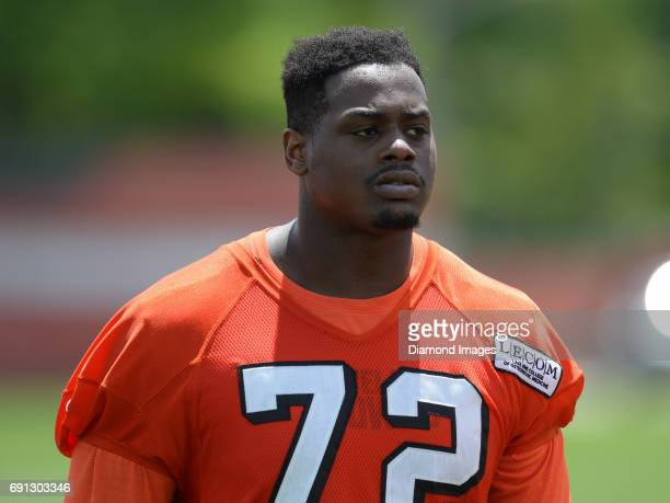 Offensive tackle Shon Coleman of the Cleveland Browns walks off the field after an OTA practice on May 31 2017 at the Cleveland Browns training...