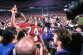 Offensive tackle Steve Wallace of the San Francisco 49ers celebrates after the 49ers defeating the San Diego Chargers in Super Bowl XXIX at Joe...