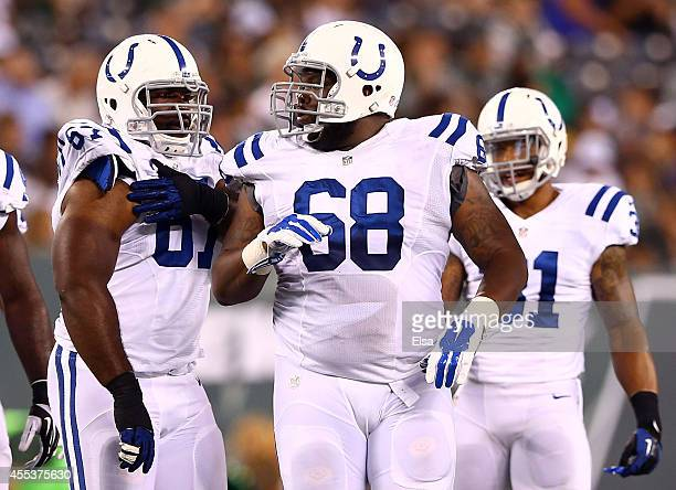Offensive tackle Ulrick John of the Indianapolis Colts looks on against the New York Jets during a preseason game at MetLife Stadium on August 7 2014...