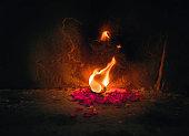 lighten up earthen candles in the ghats of Varanasi