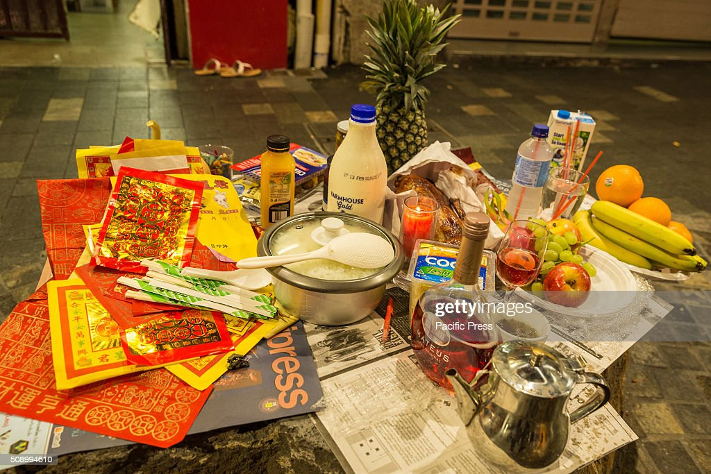 Offerings made by Thai Chinese Australians after midnight to usher in a lucky and prosperous year of the Monkey. Major landmarks across Sydney were lit in red lights, the traditional color for Luck in China, whilst colorful Chinese zodiac Lanterns were on display across the city.