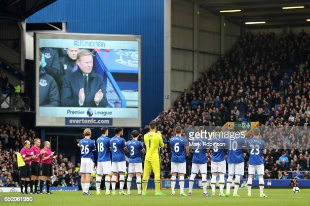 Officals players and fans take part in a minute of appluse for ex Everton player Alex Young prior to kick off during the Premier League match between...