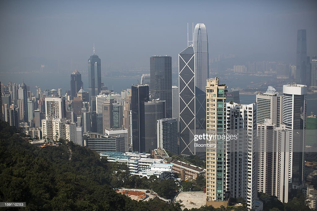 Office and residential buildings stand in Hong Kong, China, on Saturday, Jan. 5, 2013. Hong Kong topped the ranks as the most expensive office market by total occupancy cost, according to a report by CBRE Research released on Jan. 7. Photographer: Jerome Favre/Bloomberg via Getty Images
