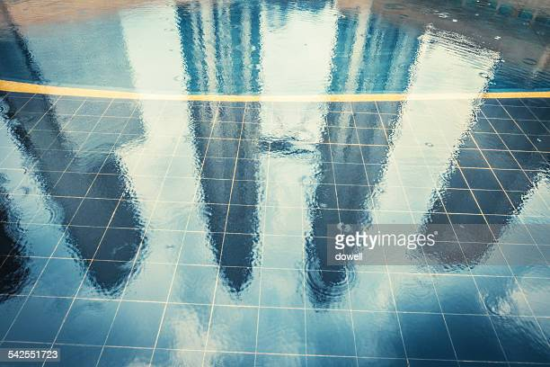 Office buidlings reflect in water after rain