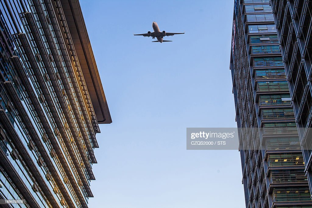 office building and airplane : Stock Photo