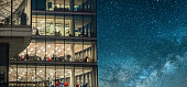 Office building at night under a beautiful starry sky