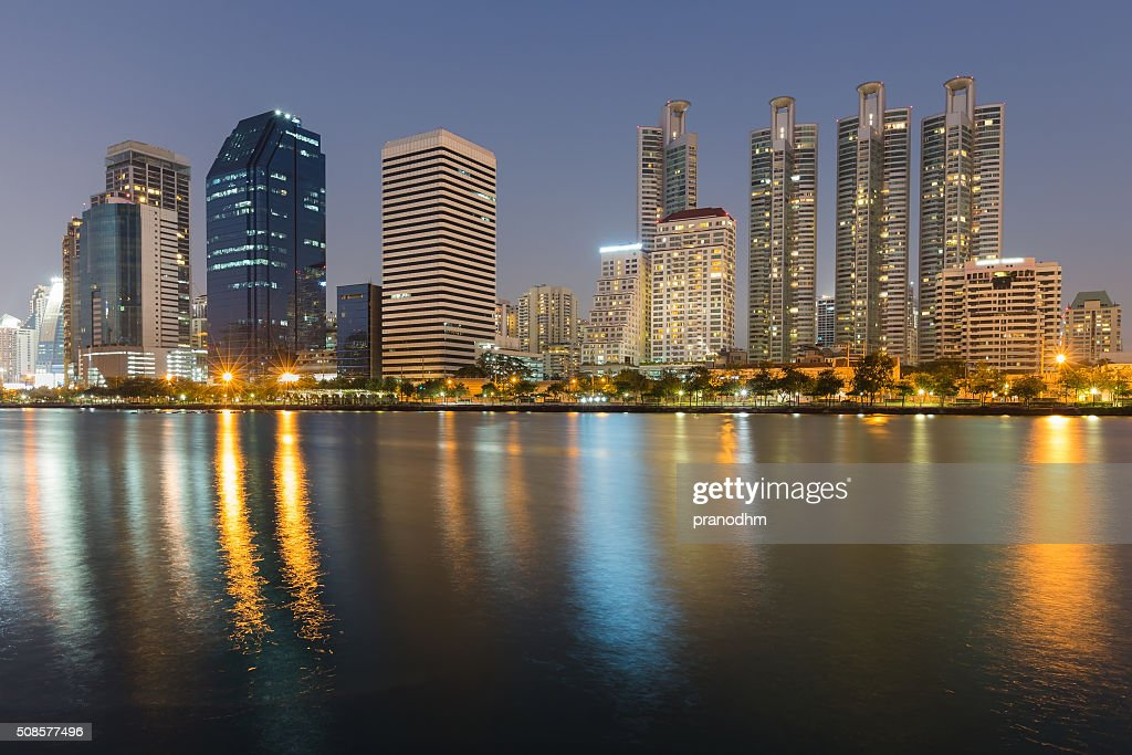 Office building water front and reflection view at night : Stock Photo