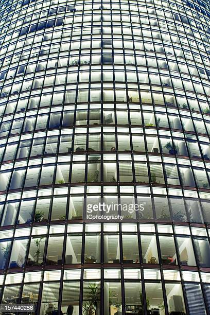 Office Building with Glass Windows at Night in Berlin Germany