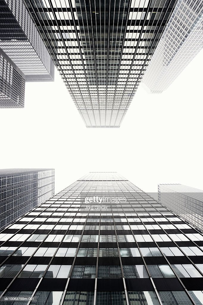 Office buildings against sky, view from below : Stock Photo