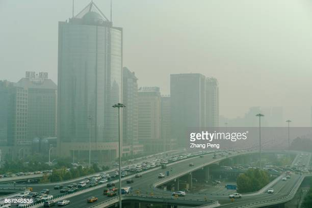 Office buildings and overpass in the heavy haze at Beijing CBD A severe air pollution attacks Beijing after the 19th National Congress of CPC