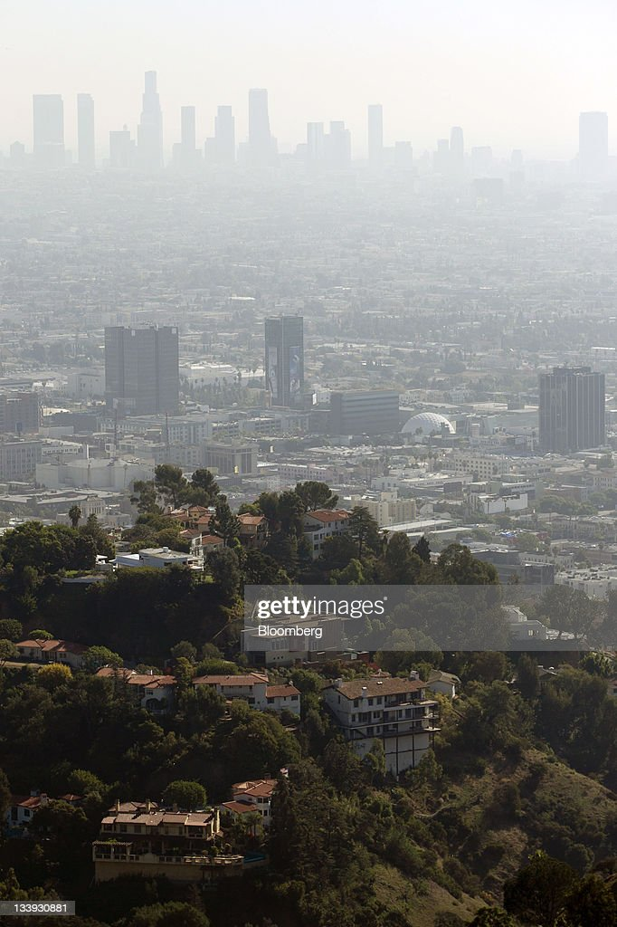 Office buildings as seen from Runyon Canyon Park stand in downtown Los Angles, California, U.S, on Thursday, Nov. 17, 2011. Los Angeles faces an almost $200 million deficit for the 2013 fiscal year and projected pension and salary increases for city employees totaling $479 million through 2015, analysts said this year. Photographer: Andrew Harrer/Bloomberg via Getty Images