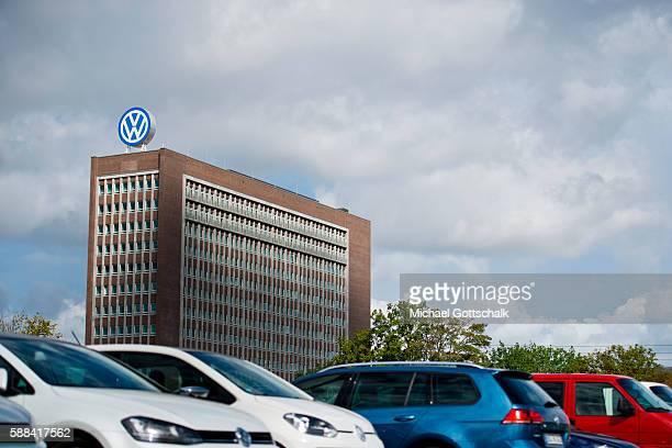 Office Builiding of Volkswagen AG headquarters seen behind VW employees car park on August 09 2016 in Wolfsburg Germany