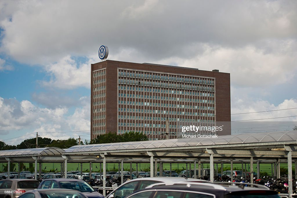 Office Builiding of Volkswagen AG headquarters seen behind VW employees car park on August 09, 2016 in Wolfsburg, Germany.