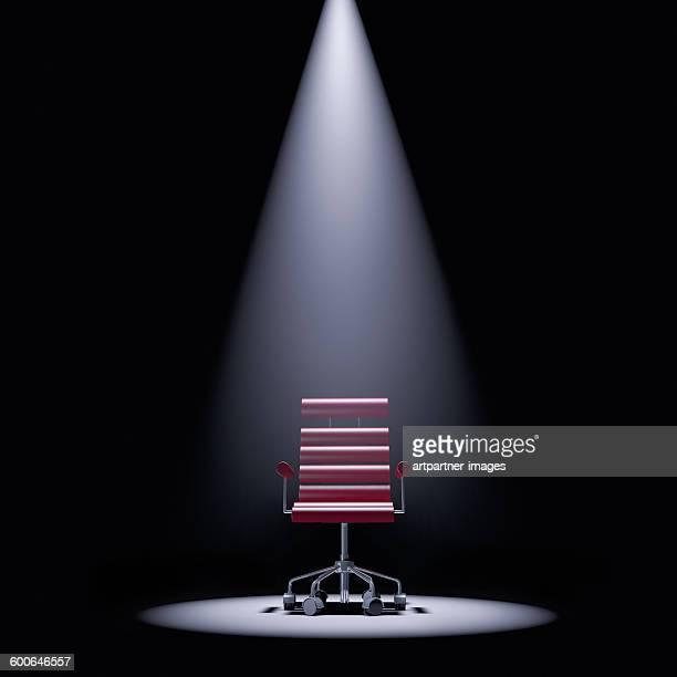 Office chair in a spotlight