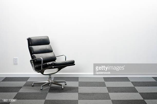 Office Chair in Room With Checkered Carpeting