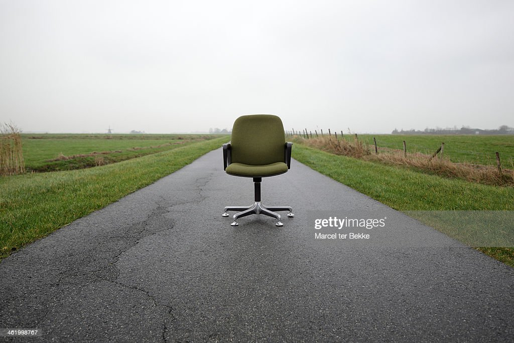 Office chair on country road