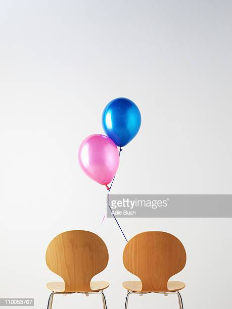 Office Chairs and connected balloons