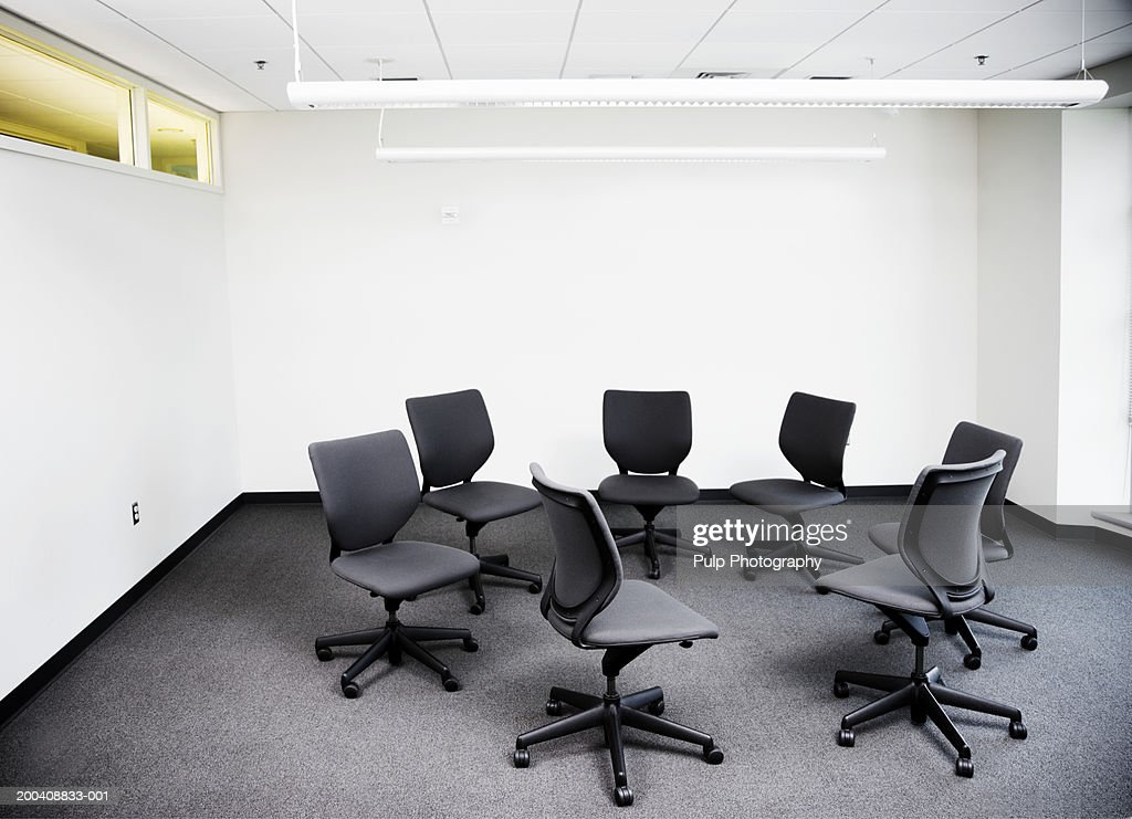 Office chairs in circle, in empty office : Stock Photo