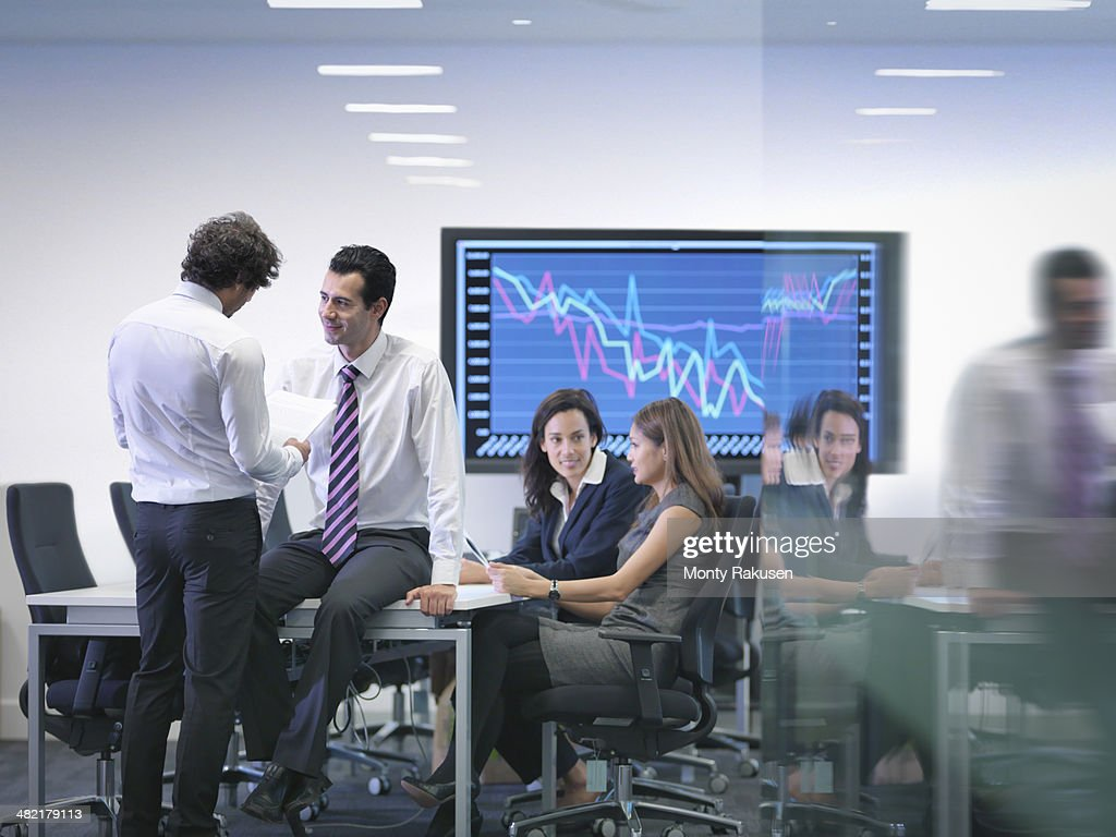 Office colleagues in informal meeting : Stock Photo