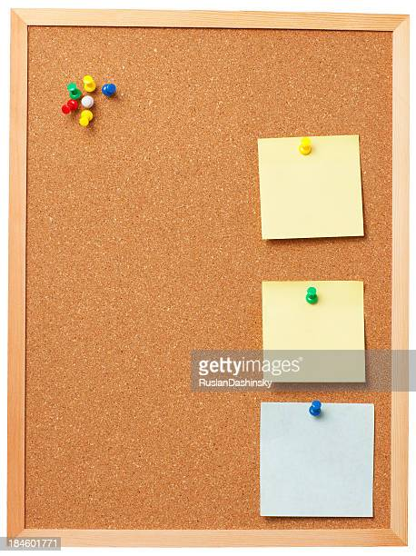 Office cork board with blank memo notes.