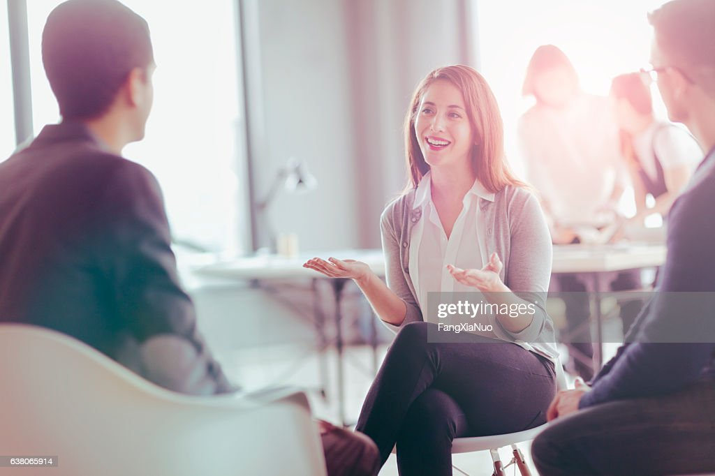 Office coworkers talking during meeting together in design studio : Stock Photo