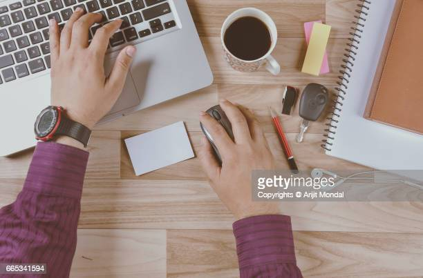 Office Desk From Above Man Working On Laptop Blank Business Card On Table Retro Styled