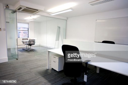 Office desk with meeting room in background : Stock Photo