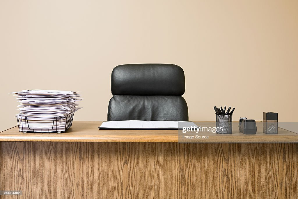 Office desk with overflowing inbox : Stock Photo