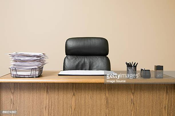 Office desk with overflowing inbox