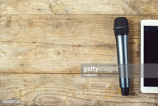 Office desk with tablet and microphone on it. : Stock Photo