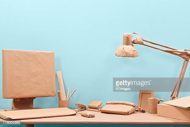 Office desk wrapped in brown paper
