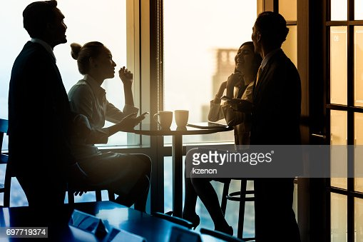 Office employees having coffee break and talking : Stock Photo