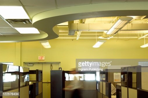 Office environment with blurring worker. : Stock Photo