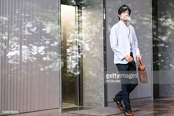 Office Executive coming out an office elevator
