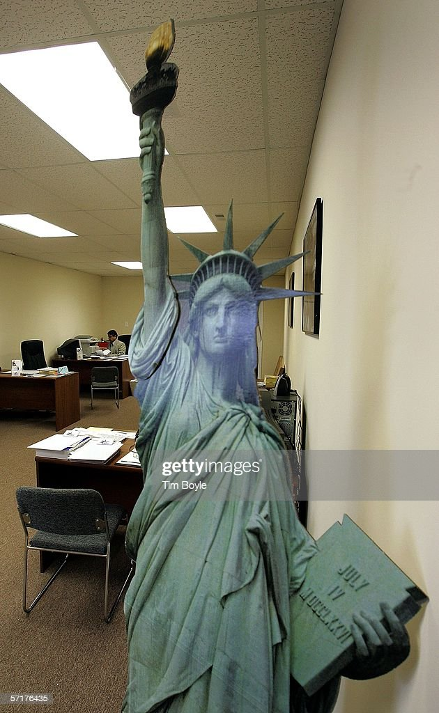 Office manager and tax preparer Al Lalani works on a client's tax return in back of cardboard model of the Statue of Liberty is seen at the Liberty Tax Service office on March 24, 2006 in Mount Prospect, Illinois. Americans are preparing for the income tax filing deadline next month whether using tax software, filing on the paper forms or using a tax preparer.