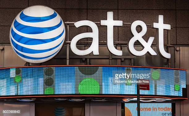 Signage and logo outside its office glowing at night ATT Inc is an American multinational telecommunications corporation headquartered at Whitacre...