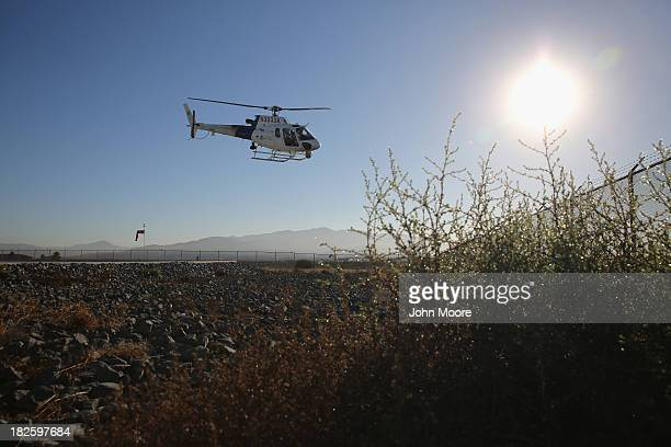S Office of Air and Marine helicopter takes off to patrol the USMexico border on October 1 2013 in San Diego California OAM helicopters support US...